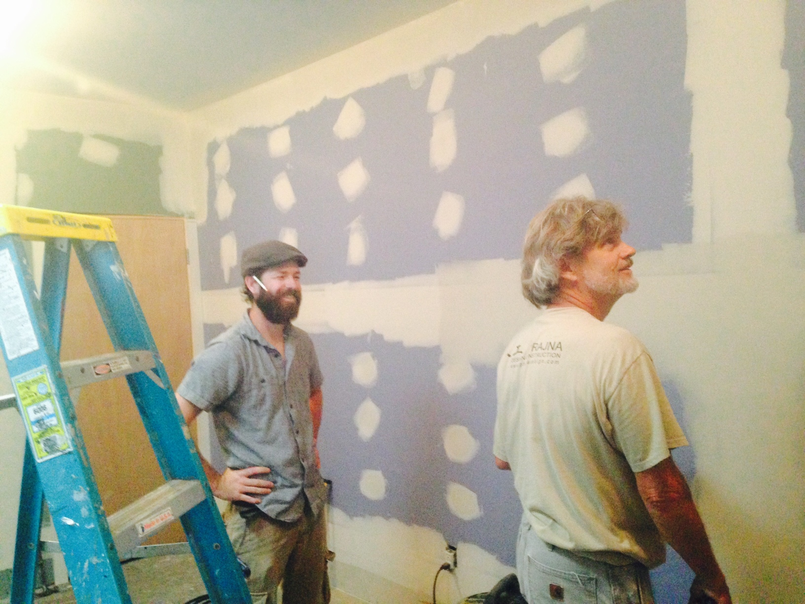 Prajna Construction owner David Wittmer (right) and fellow worker John assess the progress in one of the two sensory deprivation tank rooms at Source on High, Lexington KY.